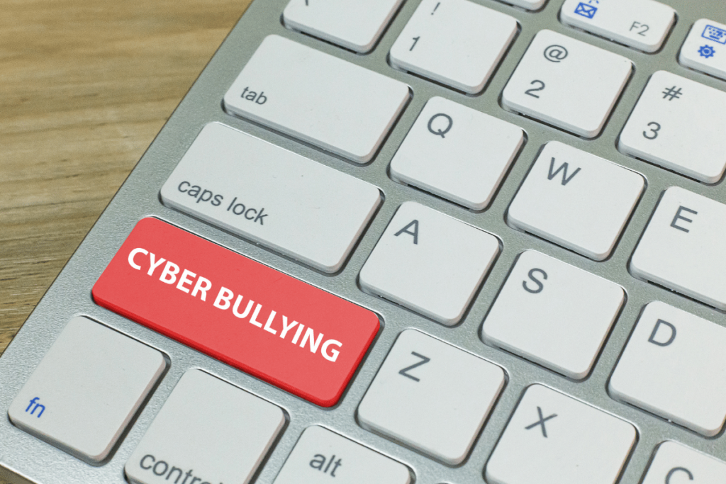 keyboard saying cyber bullying