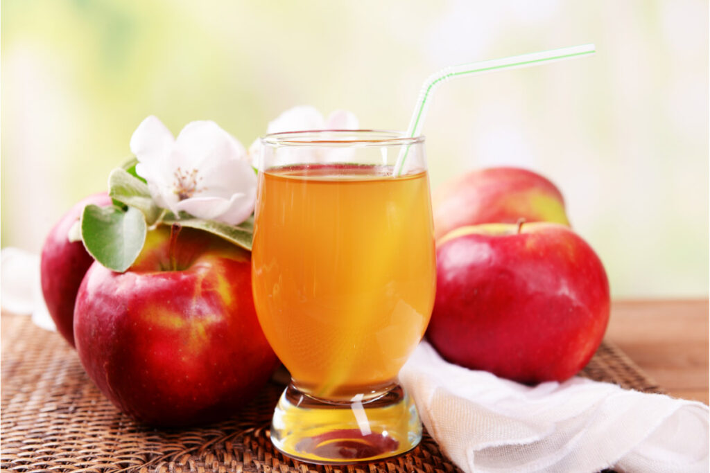 apple juice glass and apples