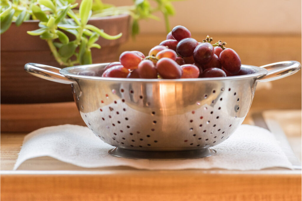 red grapes in colander