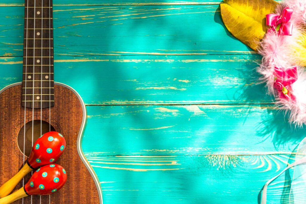 ukelele and colourful hawaiian items