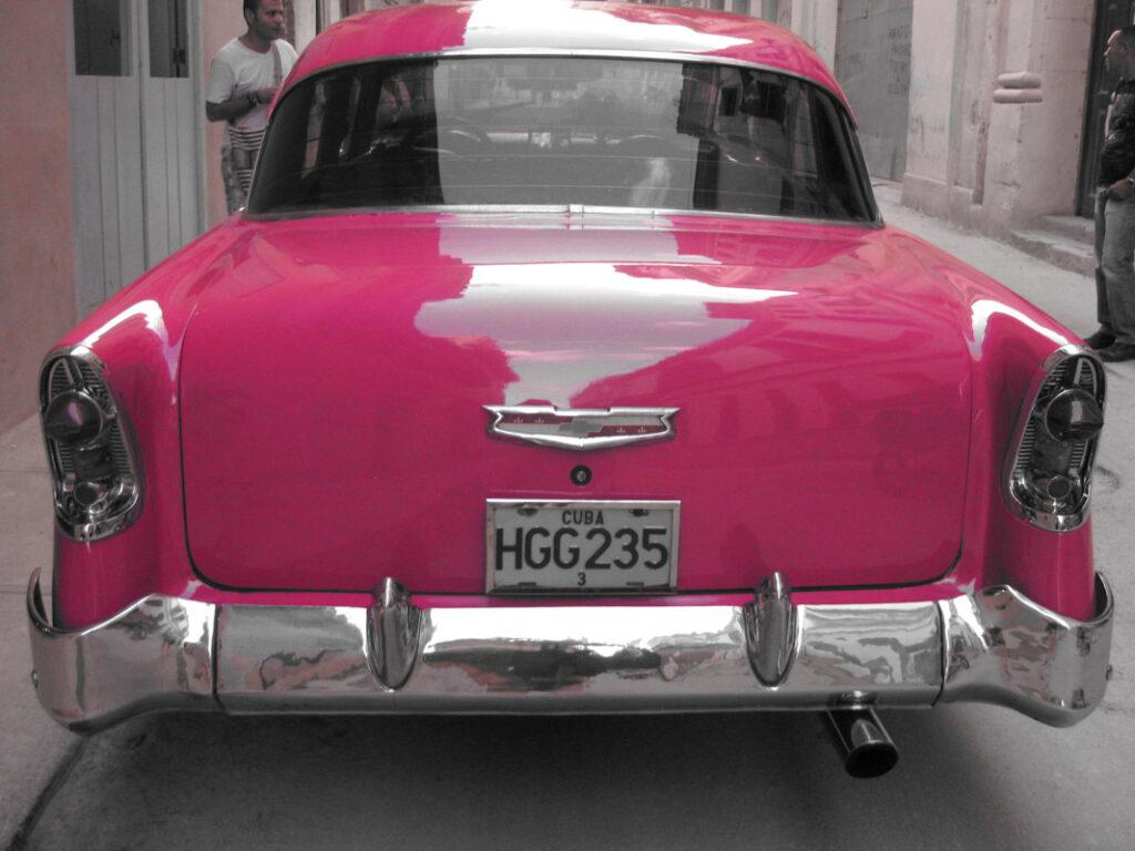 pink american car in cuba